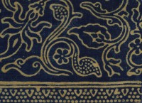 Detail of block-printed textile fragment with band of rosettes and flowers, Gujarat, 1250-1350 (Museum No: EA1990.140)