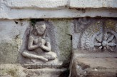 Fig. 9.  Female devotee with pendant earrings. Stone relief. Chabahil stupa,Kathmandu, 7th-8th cent. © Amy Heller