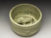 Greenware burial figure of pig in a pen