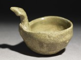 Greenware ladle with handle in the form of a bird-head (EA1956.381)