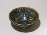 Black ware bowl with stripes
