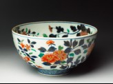 Bowl with chrysanthemum, peony, and peach sprays