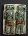 Plaque with elephant-headed warriors
