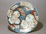 Dish with a shishi, or lion dog, amid animals and flowers (EA1976.50)