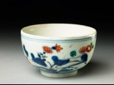 Cup with prunus and flowering plant