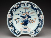 Barber's bowl depicting flowers in a vase