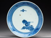 Plate with two birds under a cloud