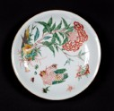 Dish with plant, hen, and six chicks