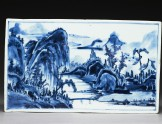 Blue-and-white tile with a landscape on one side and flowers on the other (EA1978.1174)