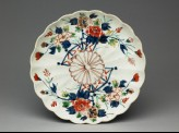 Fluted saucer dish with floral decoration