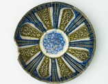 Bowl with vegetal decoration in radial panels