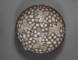Bowl with flying phoenixes against a foliate background