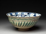 Bowl with central triangle and spiralling panels