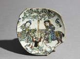 Base fragment of a dish with two men on horse-back fighting a non-human creature (EA1978.2423)