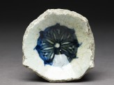 Base fragment of a bowl with blue rosette