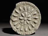 Circular roof end-tile with floral decoration