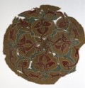 Roundel fragment with interlacing vines and leaves (EA1984.133)