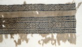 Textile fragment with bands of inverted hooks, flowers, and triangles (EA1984.154)