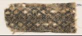Textile fragment with linked diamond-shapes and interlaced crosses