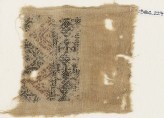 Textile fragment with linked diamond-shapes and triangles (EA1984.227)
