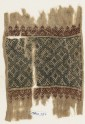 Textile fragment with linked diamond-shapes, triangles, and palmettes (EA1984.237)
