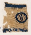 Textile fragment with circle and pseudo-inscription (EA1984.275)