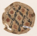 Textile fragment with rhombic shapes and squares, probably from a purse or seal-bag (EA1984.284)