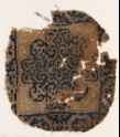 Textile fragment with rosette and scrolls (EA1984.286)