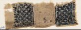 Textile fragment with grid and stylized letter (EA1984.298)