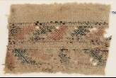 Textile fragment with bands of S-shapes and stylized shapes, possibly flowers (EA1984.333)