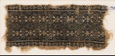 Textile fragment with linked diamond-shapes, rosettes, and possibly palmettes (EA1984.341)