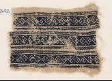 Textile fragment with bands of interlacing linked S-shapes (EA1984.342)