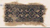 Textile fragment with interlace, and heads of serpents or birds (EA1984.346)