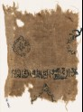 Textile fragment with band of inscription and cartouches (EA1984.36)