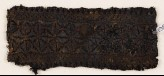 Textile fragment with band of stars or flowers (EA1984.365)