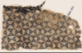 Textile fragment with linked triangles (EA1984.397)