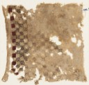 Textile fragment with swastika-filled squares (EA1984.398)