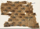 Textile fragment with repeated inscription (EA1984.402)