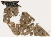 Textile fragment with eight-pointed stars or flowers (EA1984.403)