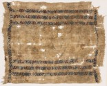 Textile fragment with six bands of diamond-shapes, crosses, and pseudo-inscription (EA1984.413)