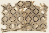 Textile fragment with circles set into a grid (EA1984.414)
