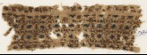 Textile fragment with diamond-shapes in squares (EA1984.421.a)