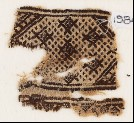 Textile fragment with diamond-shapes against a background of dots (EA1984.457)