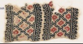 Textile fragment with linked diamond-shapes (EA1984.458)