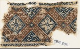 Textile fragment with eight-pointed stars surrounded by crosses (EA1984.565)