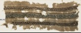 Textile fragment with three parallel bands with an interlacing chain (EA1984.572)