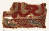 Textile fragment with remains of inscription (EA1984.72)