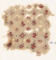 Textile fragment with rosettes, linked circles or hexagons, and inscription (EA1984.74)