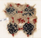 Textile fragment with lion and grid of quatrefoil flowers (EA1984.75)