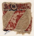 Textile fragment with lion and inscription, possibly from a bag or pocket (EA1984.87)